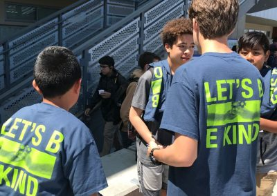 A group of students wearing Let's Be Kind T-shirts